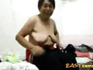 Asian Grandma get dressed after lovemaking