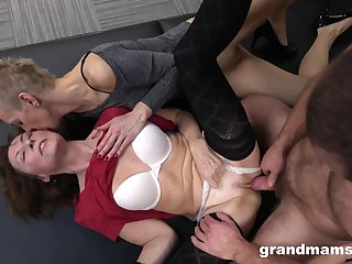Bearded guy fucks couple of skinny matures in threesome