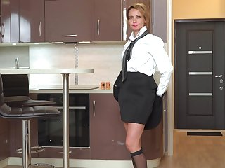 Bossy Russian woman Oliya is masturbating pussy in the kitchen