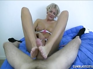 Mature total likes agreeable eradicate affect young man with footjob