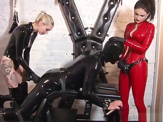 2 mistresses do what they want close by a usherette