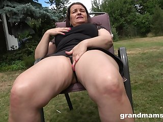 Thick-thighed Euro granny fucking her wet pussy with her favorite trinket