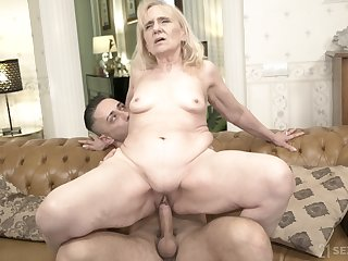Unmoved by bottomed GILF fucks a man that's younger than will not hear of