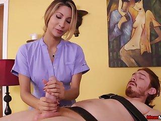 Sensual masseuse plays regarding the man's cock in a dominant way