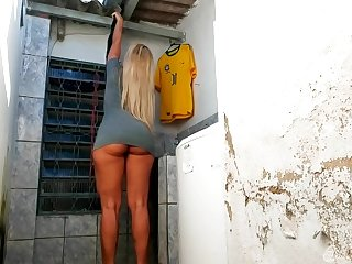 Sexy Brazilian blonde dressed in totting up unplanned gray mini dress