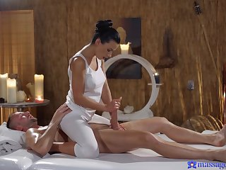 Sexy masseuse Shalina Devine oiled up and fucked by a horny client